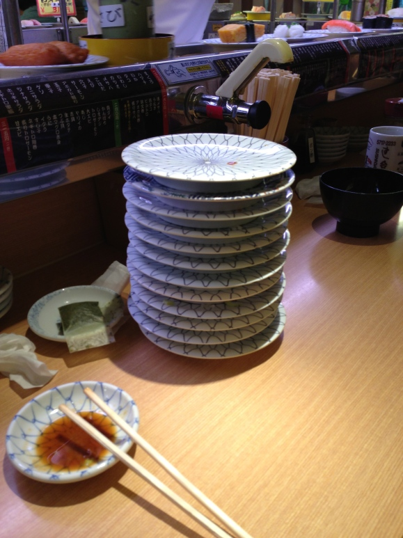 stack of plates from conveyor belt sushi