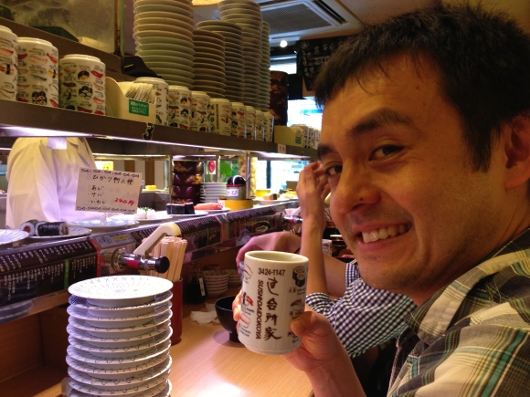 Naoto at conveyor belt sushi
