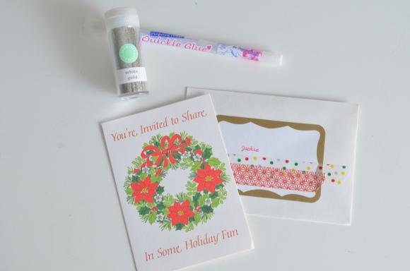 glue pen and glitter on invitation