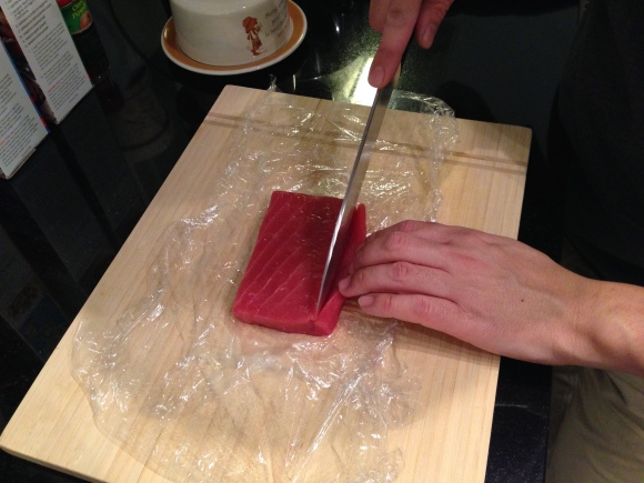 making sushi at home, slicing tuna