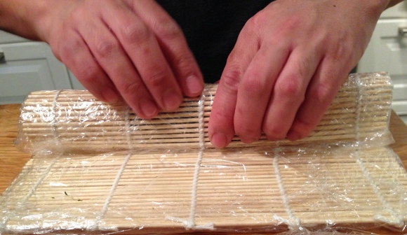 making sushi at home, rolling sushi
