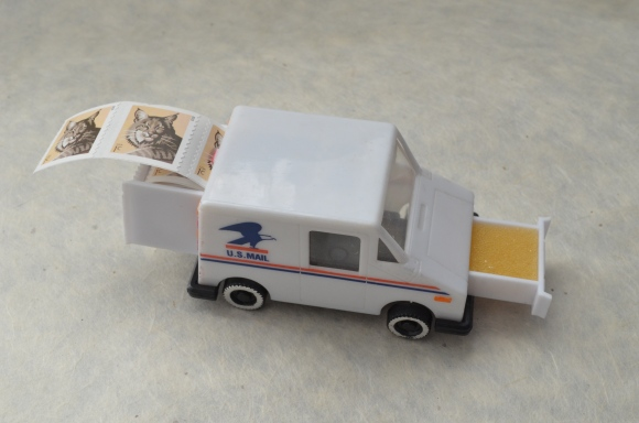vintage postal truck stamp holder, open