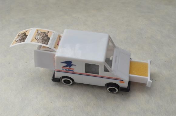 vintage postal truck stamp holder, open