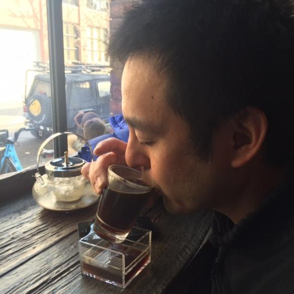 Naoto drinking a Sawada Cold Brew