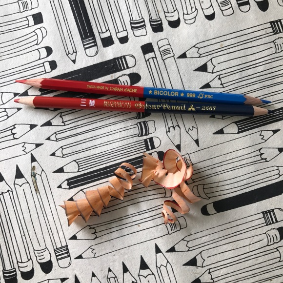 caran d'ache and mitsubishi red and blue pencils