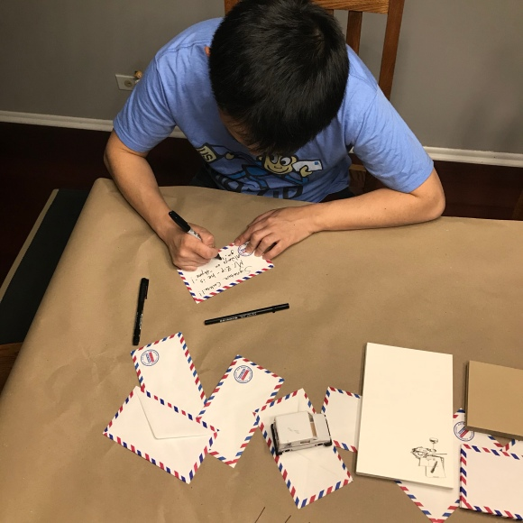 letter writing party decorations, letters & libations, paper decorations, mail decorations, kraft paper tablecloth, post office in many languages