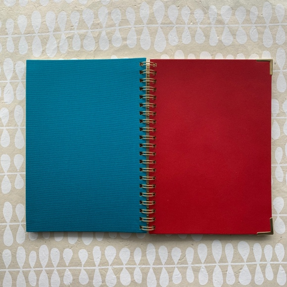 Kakimori notebook, red leather, gold accents, blue bookcloth